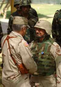 Gen. George Casey congratulates Colonel James H Coffman Jr.