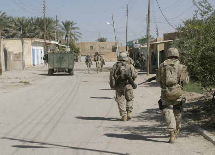 Marines from 1st Light Armored Reconnaissance Battalion patrol the streets of Barwana with Iraqi Soldiers.