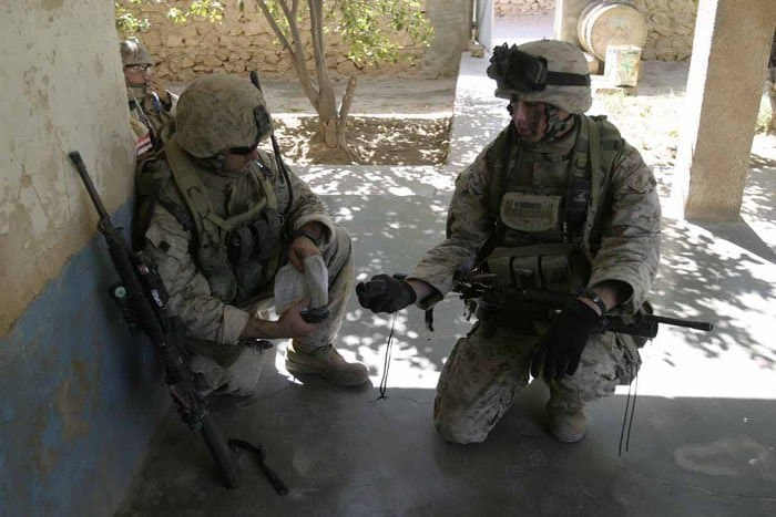 Marines work with Iraqi soldiers at a house in Barwana, Iraq