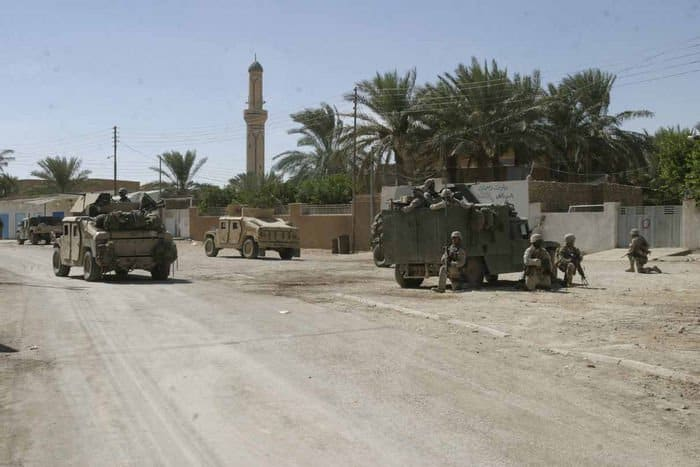U.S. Marines and Iraqi Soldiers arrive in Humvees to patrol Barwana, Iraq, as part of Operation River Gate.