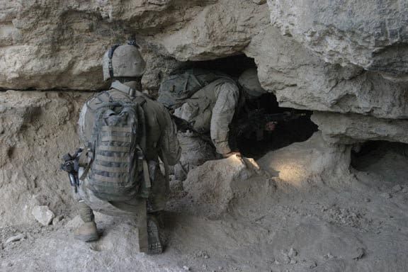 BARWANA, Iraq - Marines from Headquarters Platoon, Weapons Company, 1st Light Armored Reconnaissance Battalion search a cave in Haditha for a weapons cache during a patrol.