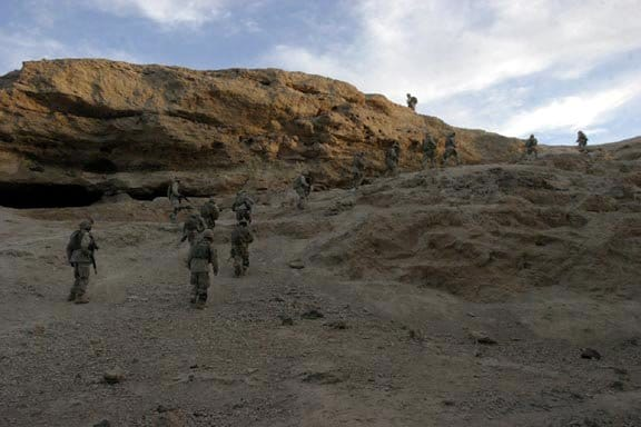 BARWANA, Iraq- Marines from 1st Light Armored Reconnaissance Battalion climb up a steep hillside during a patrol searching for weapons caches and terrorist activities.