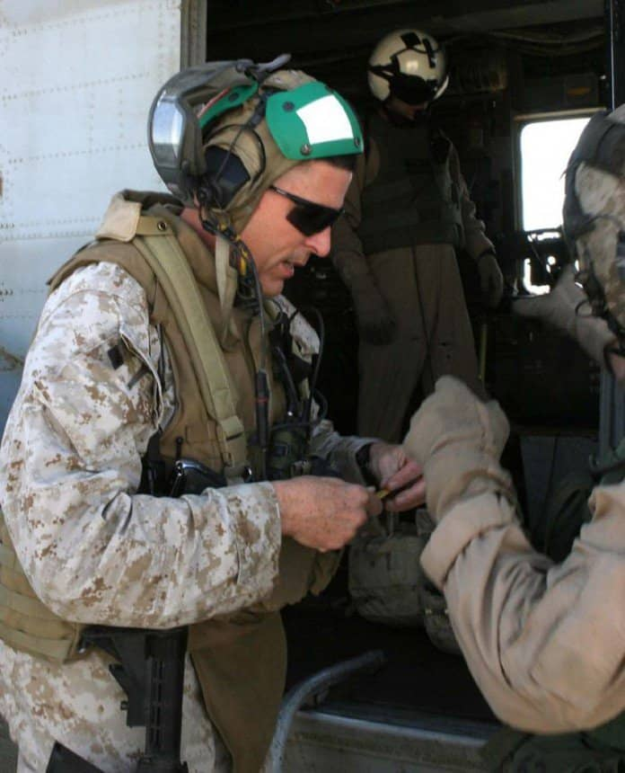 Colonel Stephen W. Davis, commanding officer, Regimental Combat Team 2, prepares to board a helicopter at Al Asad Airbase in Operation Steel Curtain.