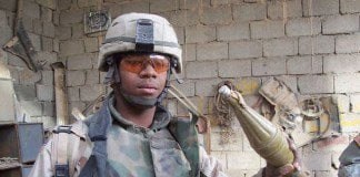 U.S. Soldier displays an explosive warhead