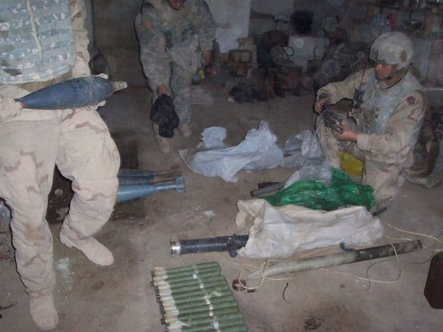 Soldiers with weapons cache.