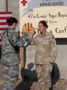 Spc. Holly Huskie reenlists
