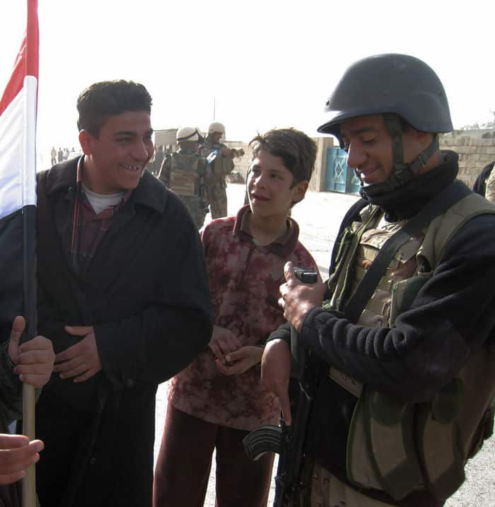 1st Battalion, 4th Brigade, 1st Iraqi Army Division soldier jokes with residents of Subiyaht