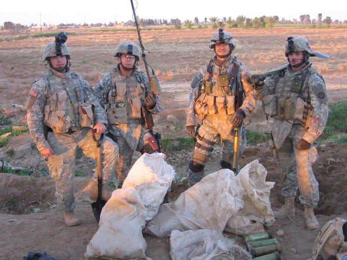 Sgt Daniel Walford, Sgt. Randall Barnason, Sgt. Thomas Scanlon, Staff Sgt. Tyler Powell display weapons cache