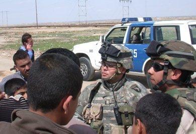1st. Lt. Yukitoshi Murasaki with Iraqi citizens