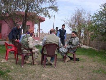 1st. Lt. Yukitoshi Murasaki with village Muktar in Allawaimahmmod, a village near Kirkuk