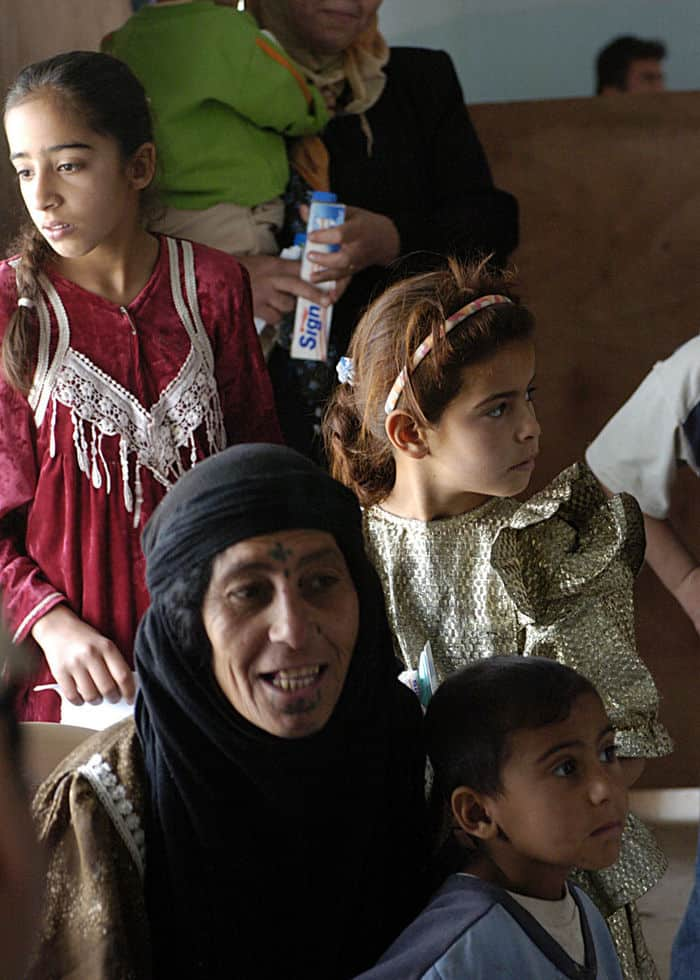 Iraqi citizens wait for dental assessment