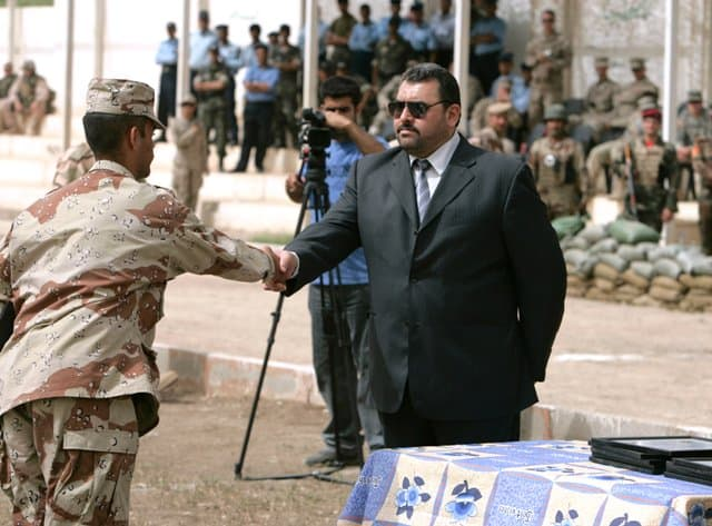 Al Anbar Governor Mamoun presents certificate to honor grad