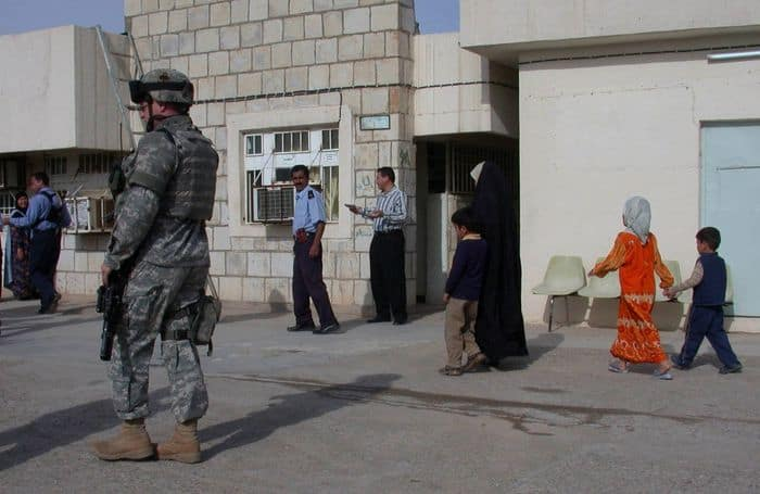 Taza based Iraqi Police officers hand out flyers