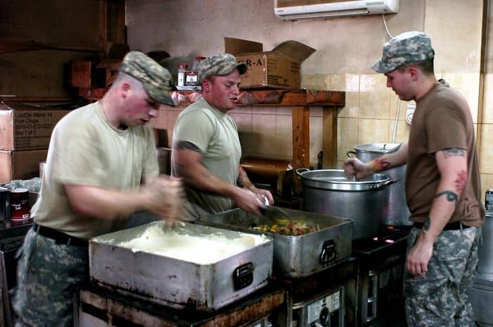 Cooks Spc. Jonathan Hill, Spc. Michael A. Lockett, and Spc. Jerald D. Jeitner, at dining facility