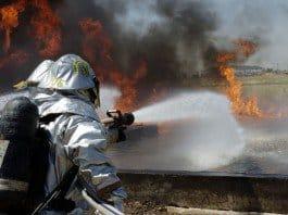 Spc. Kimberly Kissinger, Scott Higgins tackle a fuel fire