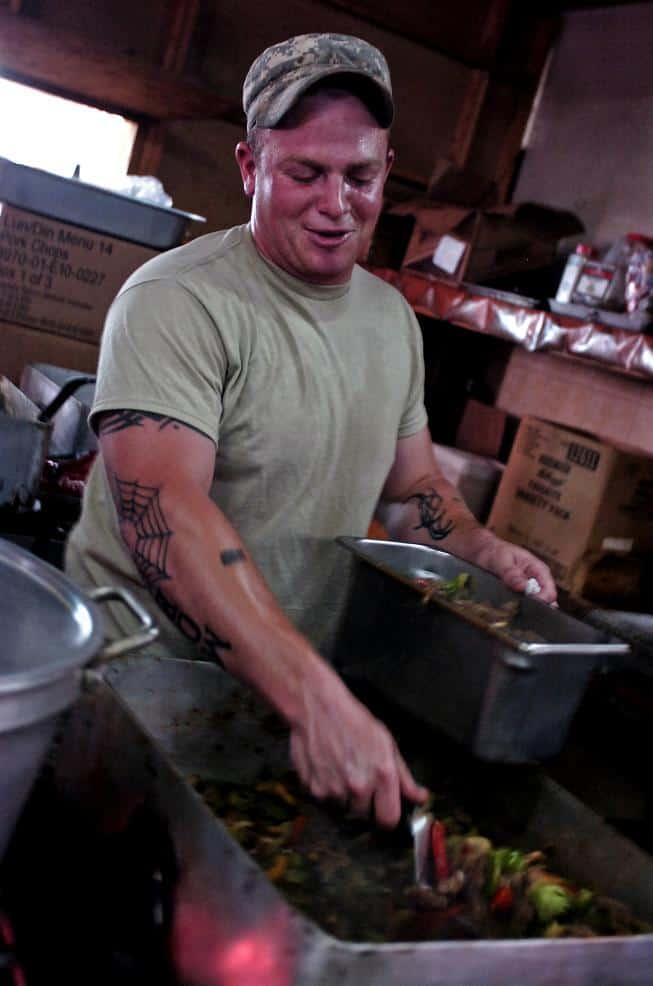 Spc. Michael A. Lockett prepares a stir fry meal