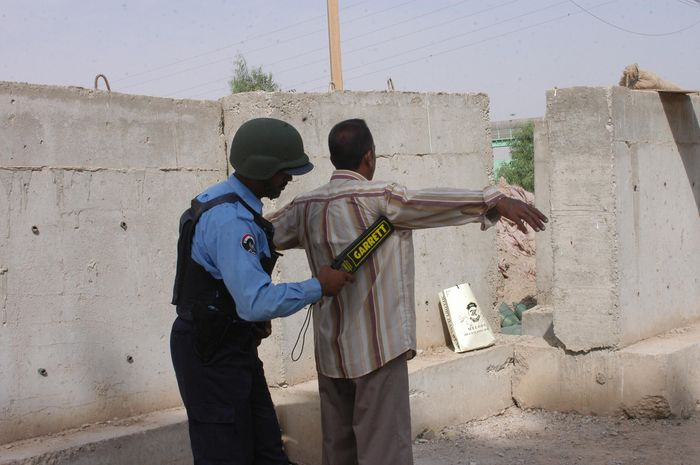 local Ramadi Policeman conducts a security search