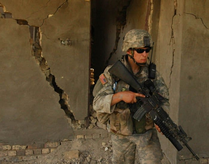 A Soldier from Alpha Co. exits a condemned building after a search