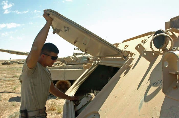 Spc. Antonio Van Dyke checks Bone Yard engine