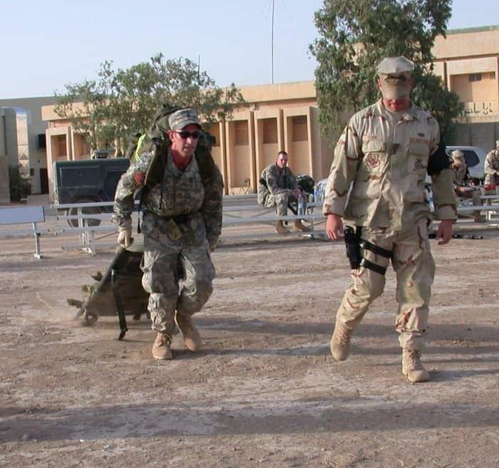 Army Staff Sgt. Becker drags a sand bag laden stretcher