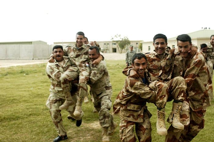Iraqi Army trainee Soldiers practice buddy carrying movements
