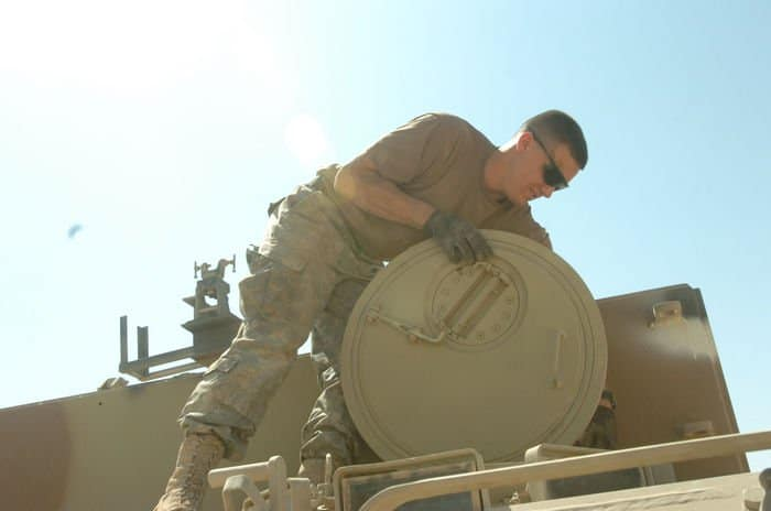 Spc. Derrick Parizek checks rescued vehicle
