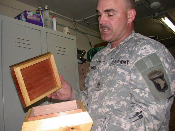SFC Frank Manroe displays an ornamental wooden box