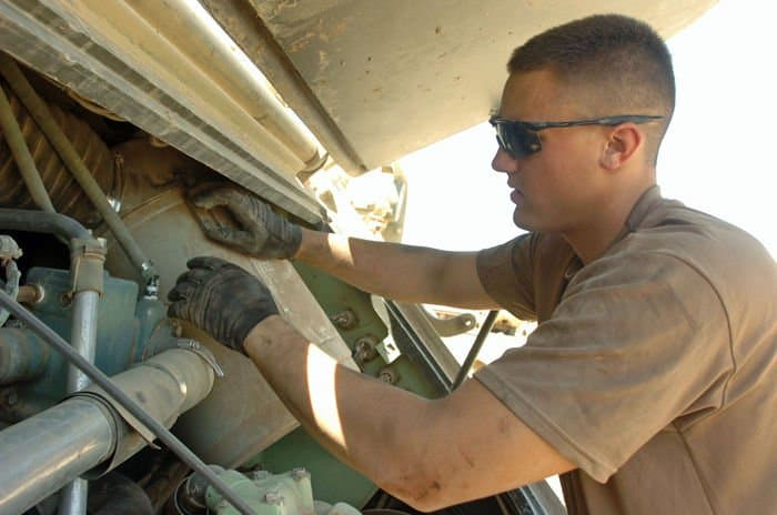 Spc. Derrick Parizek checks air filter drum