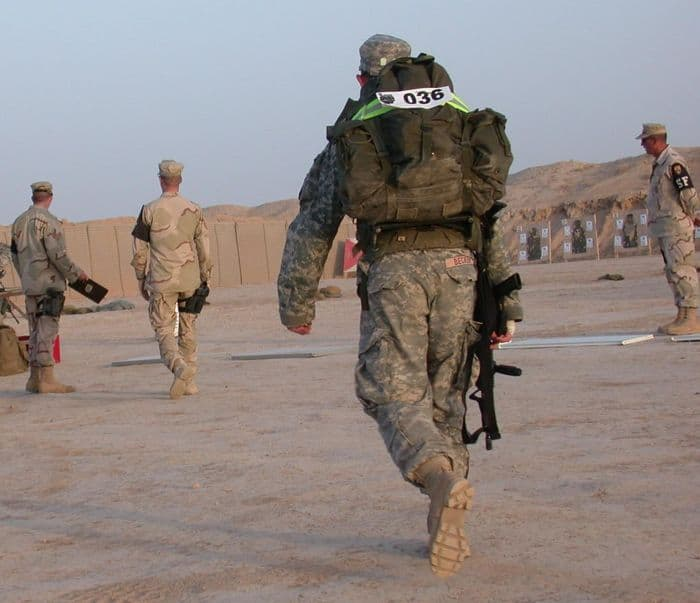 Army Staff Sgt. Becker of the 101st Airborne Division arrives at the firing range after a three and a half mile ruck march