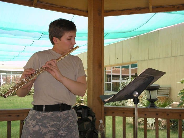 Sgt. Erica J. Coutsouridis practices playing her flute