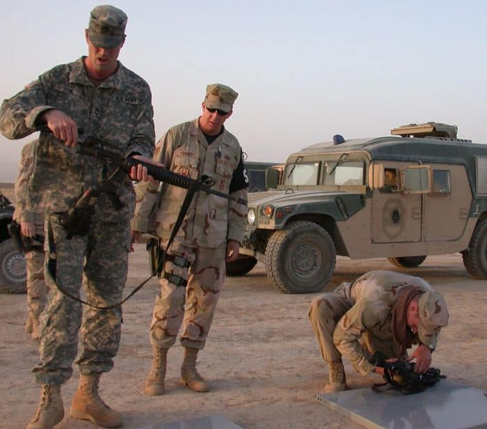 Sgt. 1st Class Sterling Deck and Airman disassemble their weapons