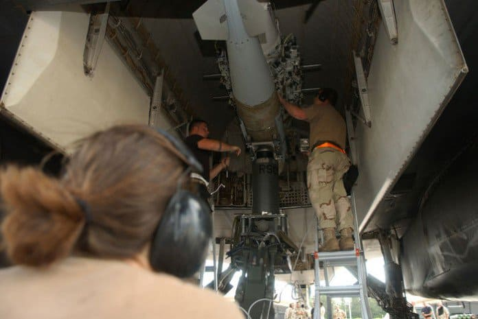 Airman 1st Class Claudia Carter (left) and Staff Sgt. James Stark (right), both from the 40th Expeditionary Maintenance Squadron, perform a 200 hour engine inspection on a B 1B Lancer