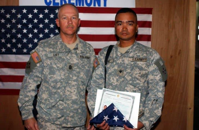 Spc. Mark Hall with Command Sgt. Maj. David List