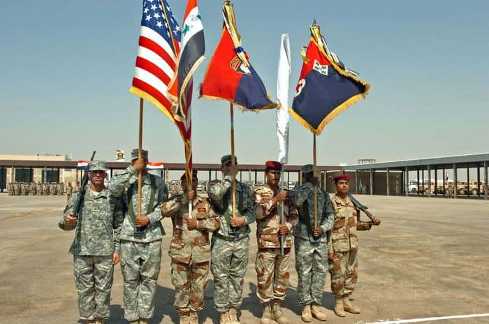 A Color Guard of Coalition and Iraqi Soldiers