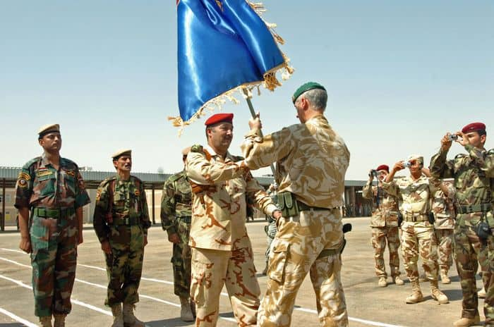 Iraqi Army Maj. Gen. Ahmed grasps his division colors