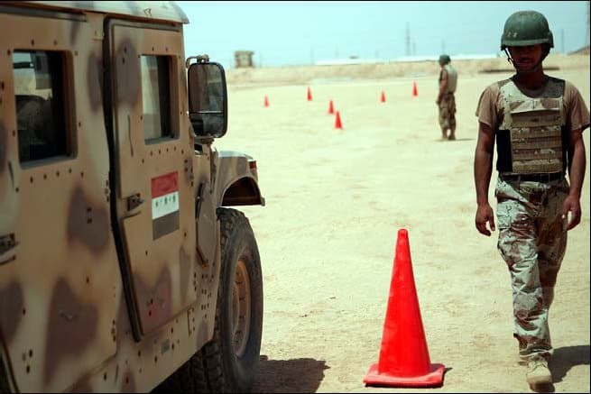 An Iraqi soldier prepares to test on the driving portion of the Humvee course.