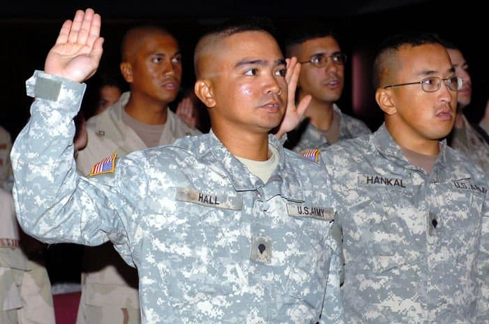 Spc. Mark Hall, a gunner for the command security detachment takes the oath of U.S. citizenship