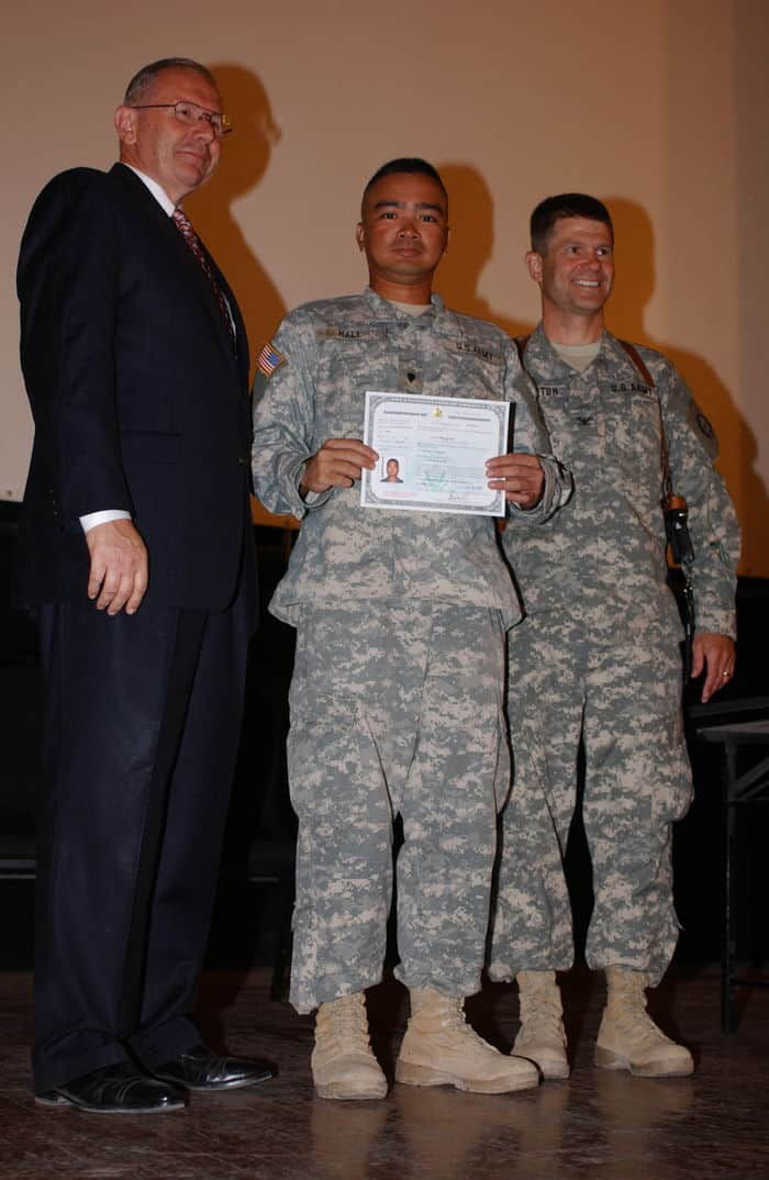 Spc. Mark Hall with Col. Mark Hampton, Jack Bulger, U.S. immigration officer