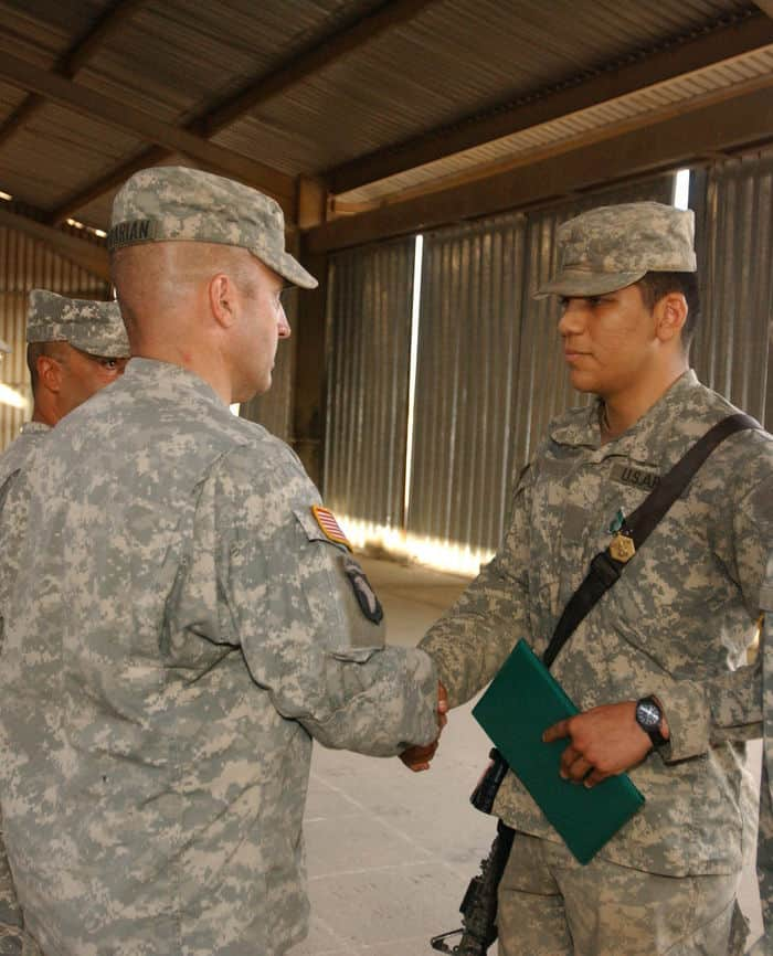 Pvt. Eleazar Garcia receives the Army Commendation Medal with Valor