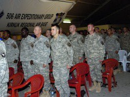 Soldiers with 1st Brigade Combat Team, 101st Airborne stand to be recognized before being inducted into the Honorable Order of St. Barbara