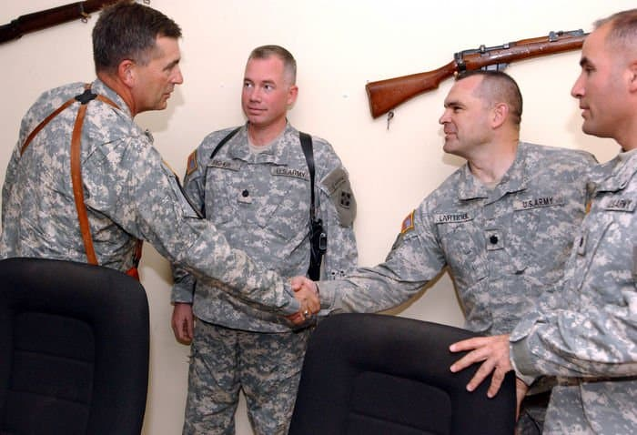 Lt. Gen. Peter Chiarelli, left, shakes hands with Lt. Col. Lou Lartigue, as Lt. Col. Chris Pappas and Lt. Col. Thomas Fisher, stand by.