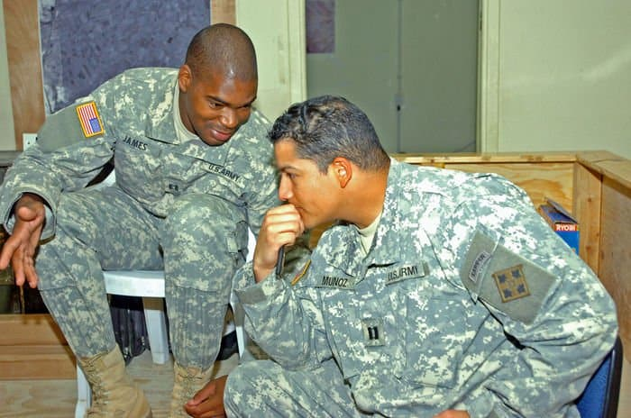 Capt. Joseph James, incoming battle captain with 5th Squadron, 73rd Cavalry, talks to Capt. Steven Munoz, outgoing battle captain
