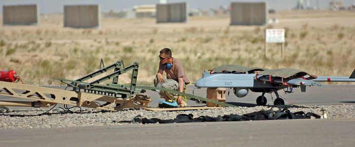 Spc. Raymond Poltera conducts pre flight inspections before launching a Shadow UAV