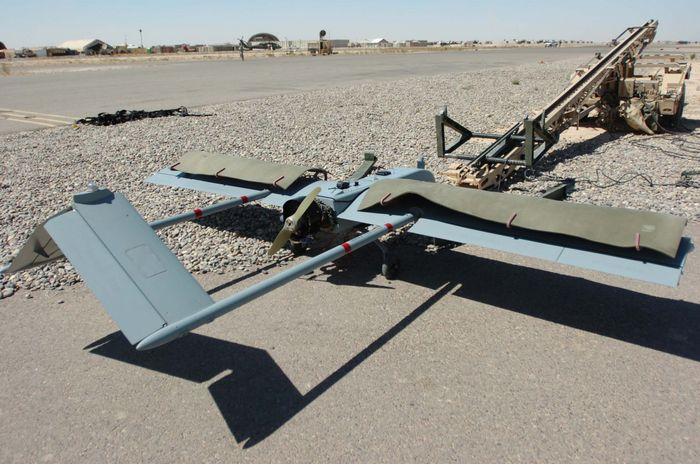 A Shadow UAV stares down its launching device during pre flight inspections