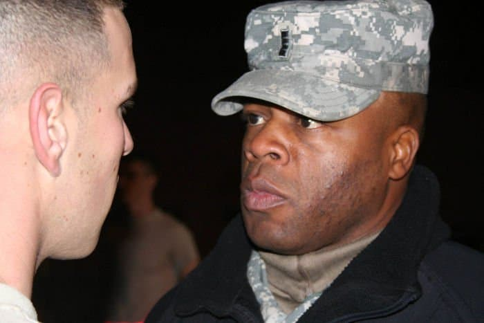 Chief Warrant Officer 4 Kenneth Woods, HHT, 2 6th Cav. Regiment instills a spur candidate with a strong sense of encouragement