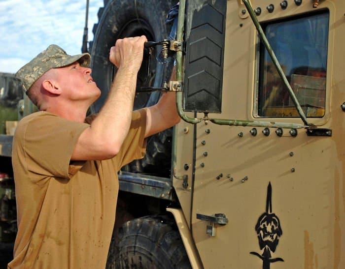 Capt. Eric Sutton, HHT, 2 6th Cav. Regiment, washes a vehicle