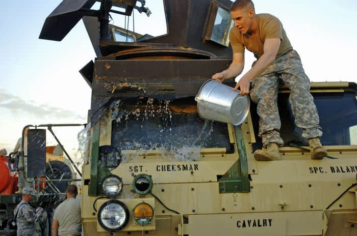 Pfc. John Lott, HHT, 2 6th Cav. Reg., rinses off a truck