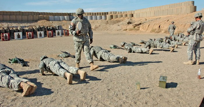 Sgt. Desmont Upchurch, E Troop, 2 6th Cav. Regiment gives Soldiers on the firing range a little encouragement during a spur ride at FOB Warrior