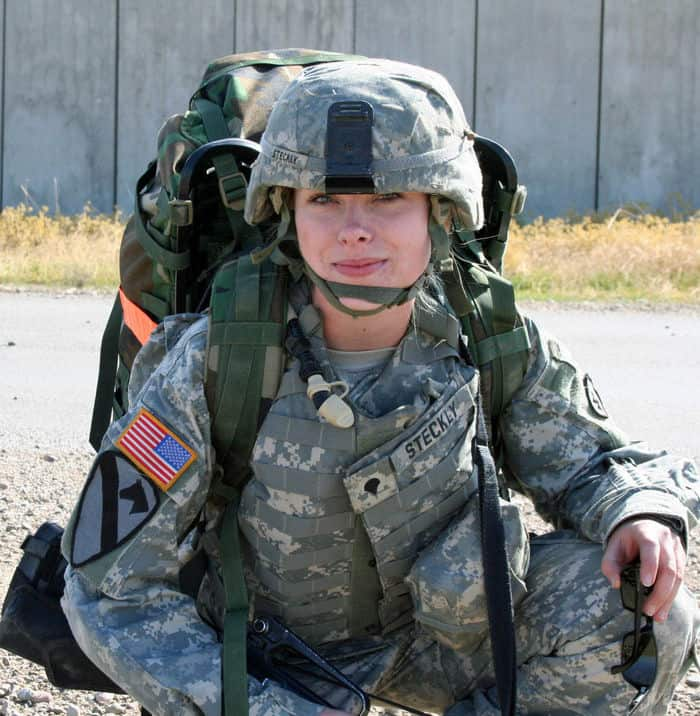 Spc. Laura Steckly, E Troop, 2 6th Cav. Regiment takes a knee and prepares to pull security during the road march portion of a spur ride
