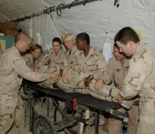EMEDS team practices stabilizing a patient cervical spine